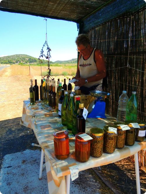 Man selling wine and other goods from his land