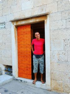 Josko Pecarevic at the door to his family's wine cellar