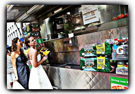Me & Tara stopping for a pretzel during the wedding day shoot..It was a joke but very much our character to do so!